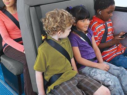 Students in a bus seat